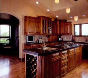 Dark maple wood kitchen cabinets and island custom made for a home in Grand Junction