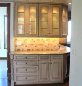 Custom made painted and glazed alder wood butler's pantry for a home in Denver