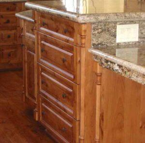 Knotty alder wood kitchen cabinets custom made for a home in Denver