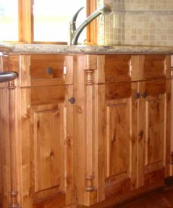 Knotty alder wood kitchen cabinets custom made for a home in Denver
