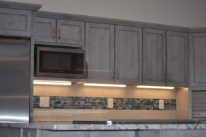 photo of Grand Junction, Colo. • Residential Kitchen Remodel • Medallion Cabinets in knotty alder wood • peppercorn finish