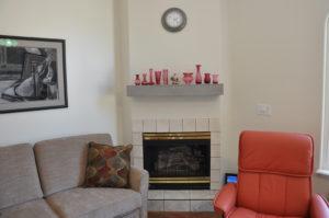 photo of Grand Junction, Colo residential custom millwork mantel • knotty alder wood • peppercorn finish