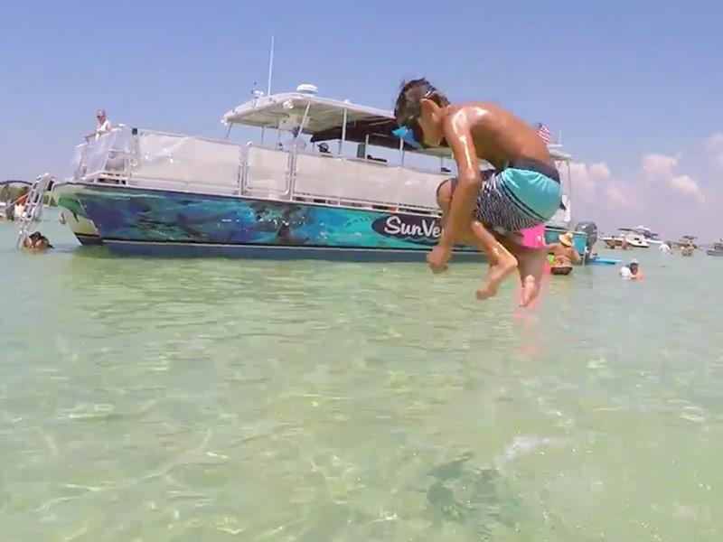 Boy Jumping into Water Crab Island Destin Florida