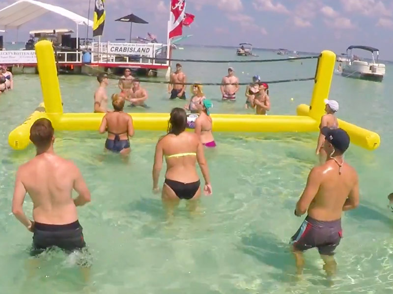 Playing VolleyBall Crab Island Destin Florida