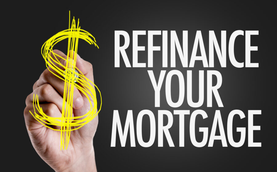 Hand writing the text: Refinance Your Mortgage
