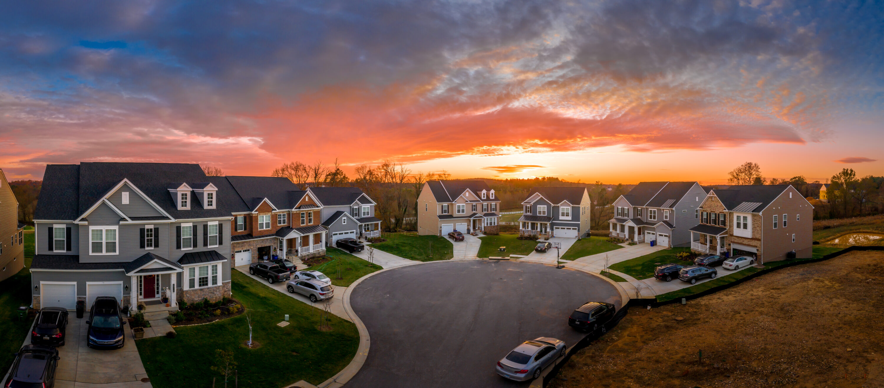 Overhead neighborhood picture of houses at sunset.