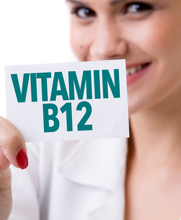 woman holding vitamin B12 sign