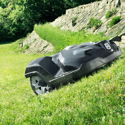 An auto-mower mowing the grass