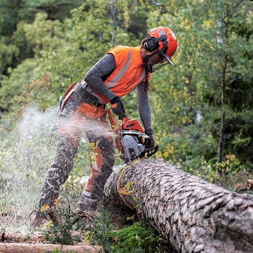 woman using a chainsaw