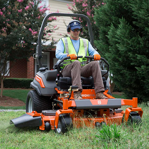 man riding a mower