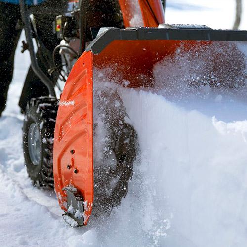 a snow tire gripping snow