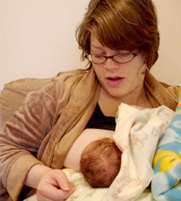 New mom with her baby the day after her home birth