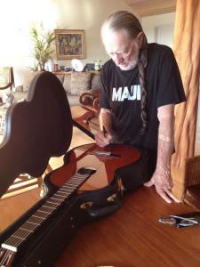Willie_Signing_Guitar_Web