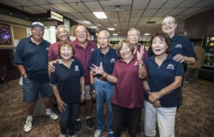 A few of the members of Nikkei Seniors bowling group gather for a photo between games at the Linbrook Bowling Center in Anaheim. The group bowls on Thursday morning at the center. MARK RIGHTMIRE, THE OC REGISTER