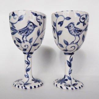 Danasimson.com Custom Wedding goblets; happy nest Delft blue brushwork featuring a garden and birds.