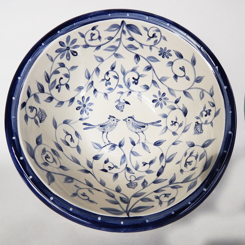"""Danasimson.com Delft Blue birds """"Happy.nest"""" bowl has hand painted love birds in a garden with acorns signifying long love."""