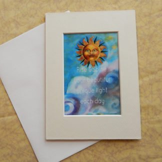 """Danasimson.com Matted art card with envelope, """"Rise and shine your beautiful unique light each day"""" quote, sun face image."""