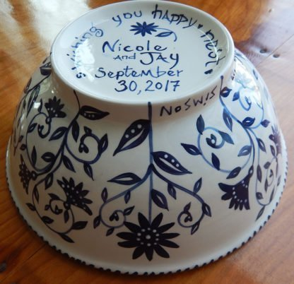 side view of outside of happy nest bowl with bride and groom's names and wedding date hand painted on bottom