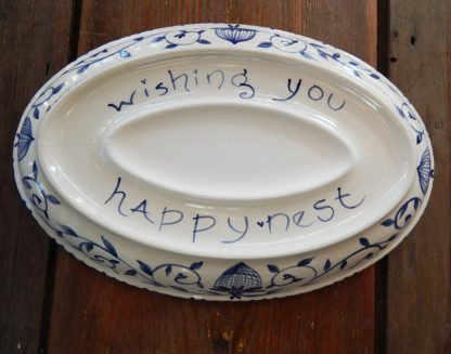 """Danasimson.com Delft Blue birds """"Happy.nest"""" Platter showing the bottom with phrase and where a personalized message or names would go."""