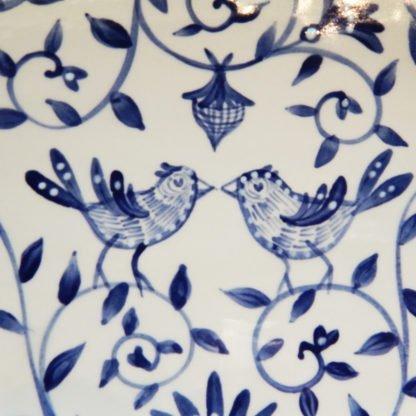 "Danasimson.com Delft Blue birds ""Happy.nest"" Platter closeup of two birds brush work."