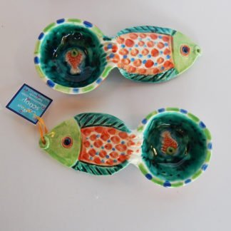 """Danasimson.com Our handmade Fish handle Coffee Scoop is about 7 inches by 3,"""" in colorful ceramic. The handle is a raised design of a fish. A smaller fish is in the bowl of the scoop."""