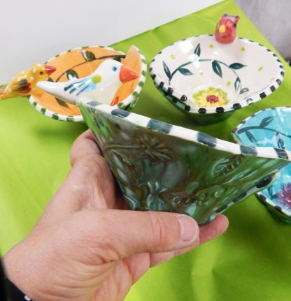 Danasimson.com The side view of the handmade ceramic bird bowl with the flow glaze defining a garden pattern