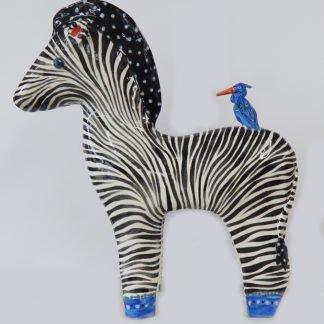 Danasimson.com Large zebra sculpture with little blue heron on his back