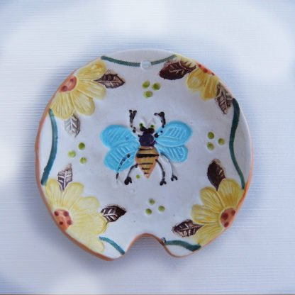Danasimson.com Handmade ceramic honey bee spoon rest with raised detail.