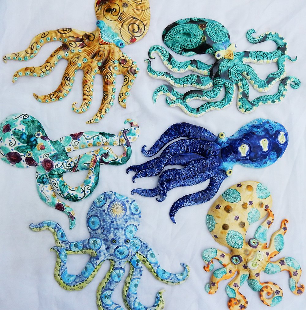 a variety of handmade ceramic octopus