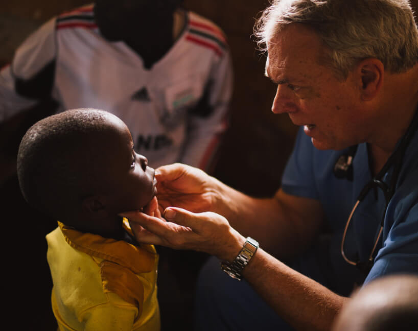 Doctor helping young patient.