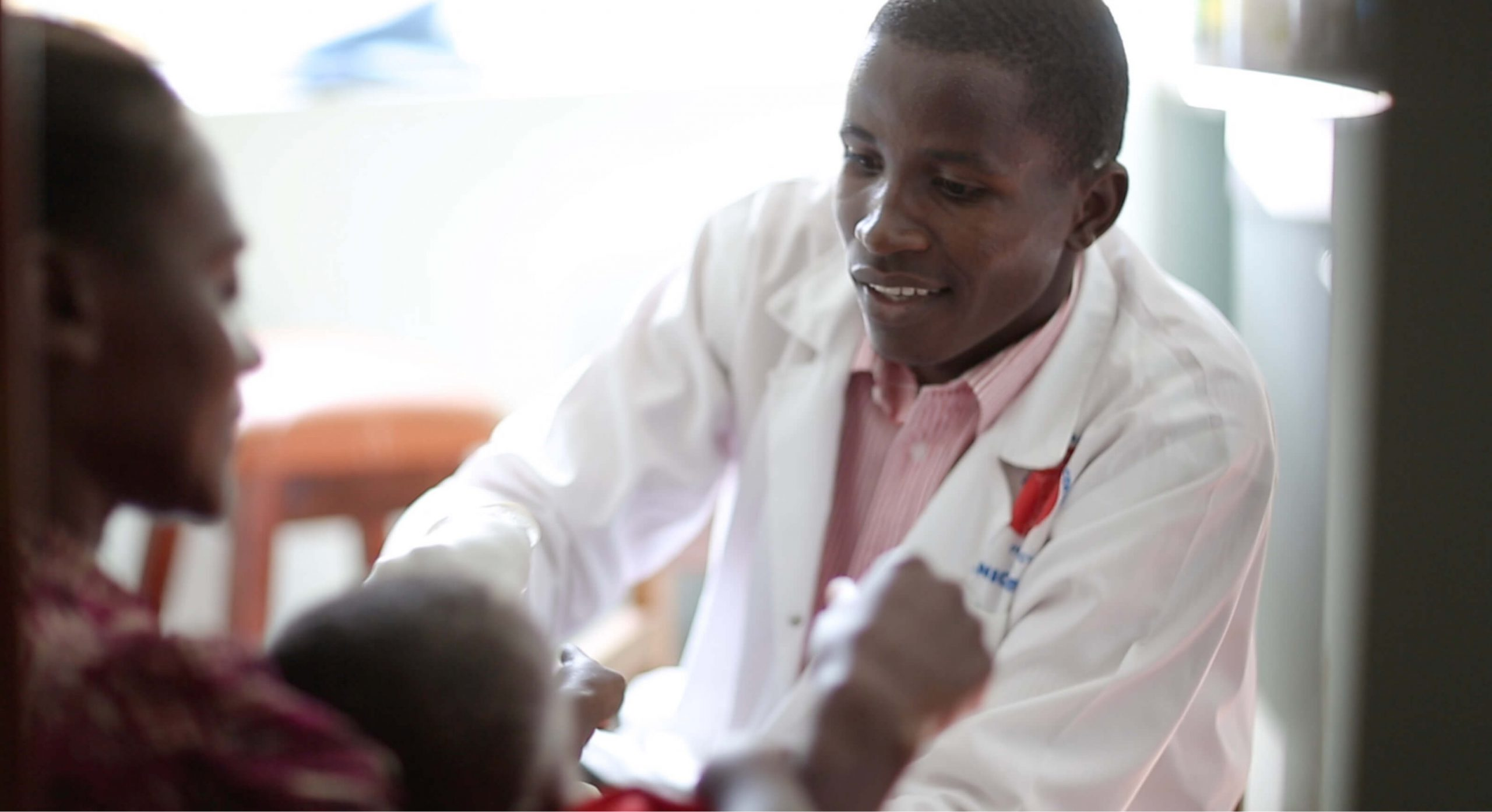 a doctor helping a child