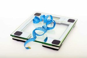 Ask Mr. Pedometer and Friends about weight loss and obesity - scale and measuring tape