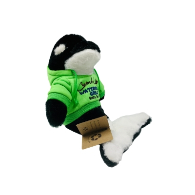 killer whale toy in green hoodie