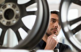 male customer choosing wheel rims at car service