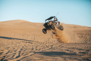 Dune buggy jumping dunes at the oceanic dunes recreational vehicle area