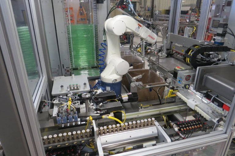 A DENSO robot for box packaging multiple product types.