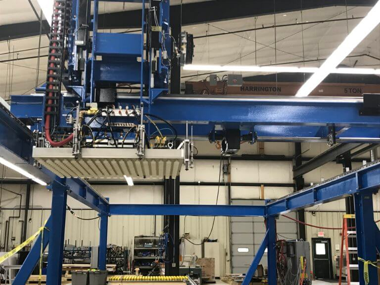 An overhead three-axis gantry robot with large vacuum end-of-arm-tool.