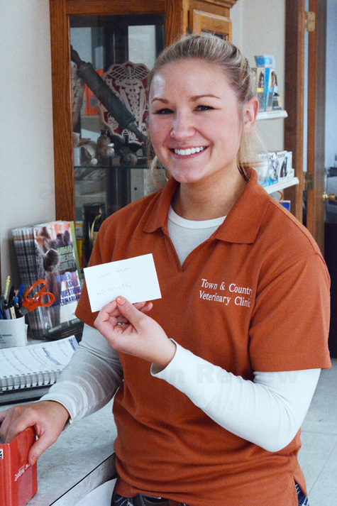 Kari Schindler draws the winning name this afternoon at Town & Country Vet Clinic.