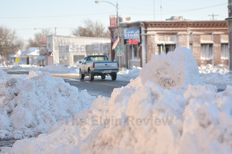 Downtown Elgin, Nebraska is cleaning up following latest snow storm.  The Elgin Review