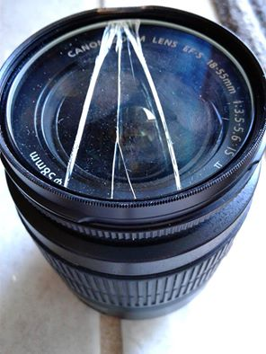 Busted camera filter and jammed lens