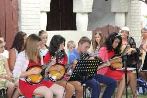 Children's orchestra at Simpetru with instruments purchased by Crawford FBC