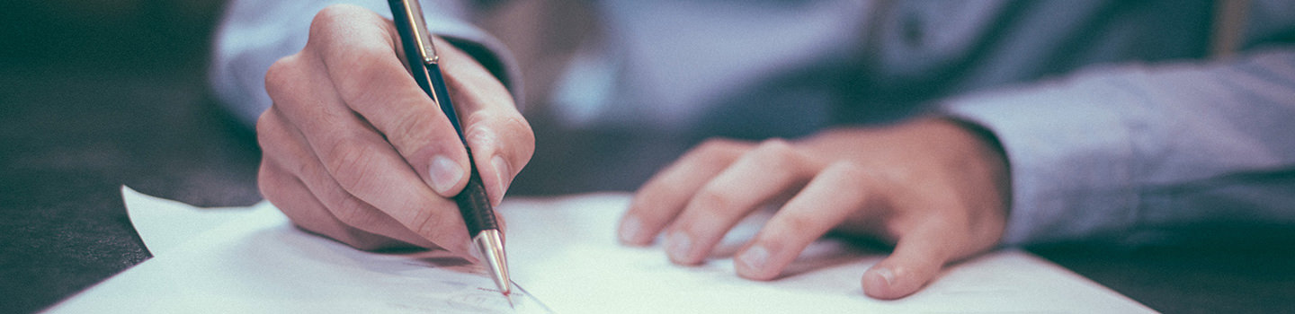 Blog Banner Picture - Person writing on a paper