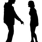 Silhouettes of a man and woman arguing