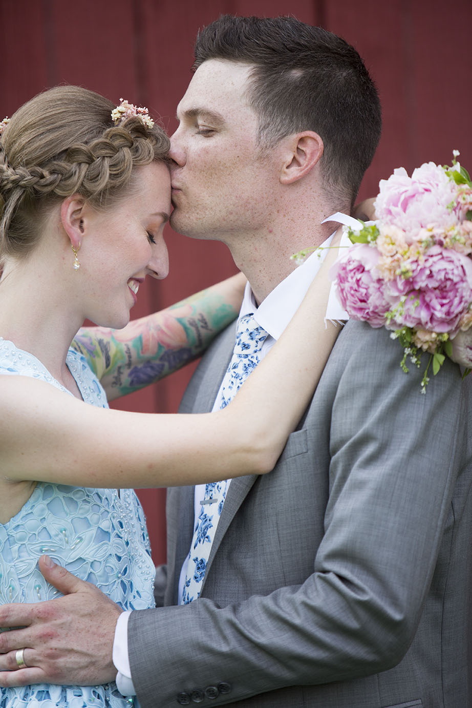 Groom kisses brides forehead Ypsilanti wedding