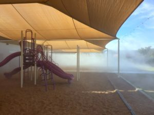 Shaded playground with mist