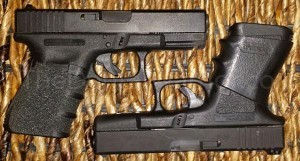 A Glock 23 (.40-cal) on top, and a Glock 19 (9-mm) on bottom.