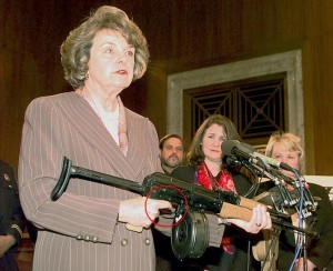 Senator Diane Feinstein recklessly endangers audience.  Real gun.  Magazine inserted.  FINGER ON THE TRIGGER.  And, she POINTING IT AT THE AUDIENCE.