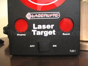 "After shooting at the target, you fire the laser at the ""Display"" sensor to display your hits. Then you can shoot the ""Reset"" sensor to clear them and start over."