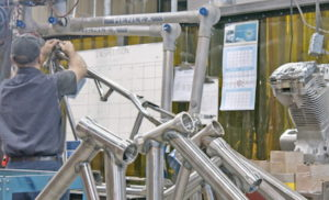 Worker at motorcycle manufacturing wearhouse