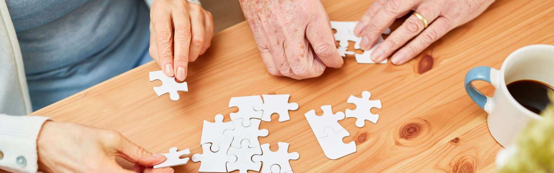 elderly people playing puzzle